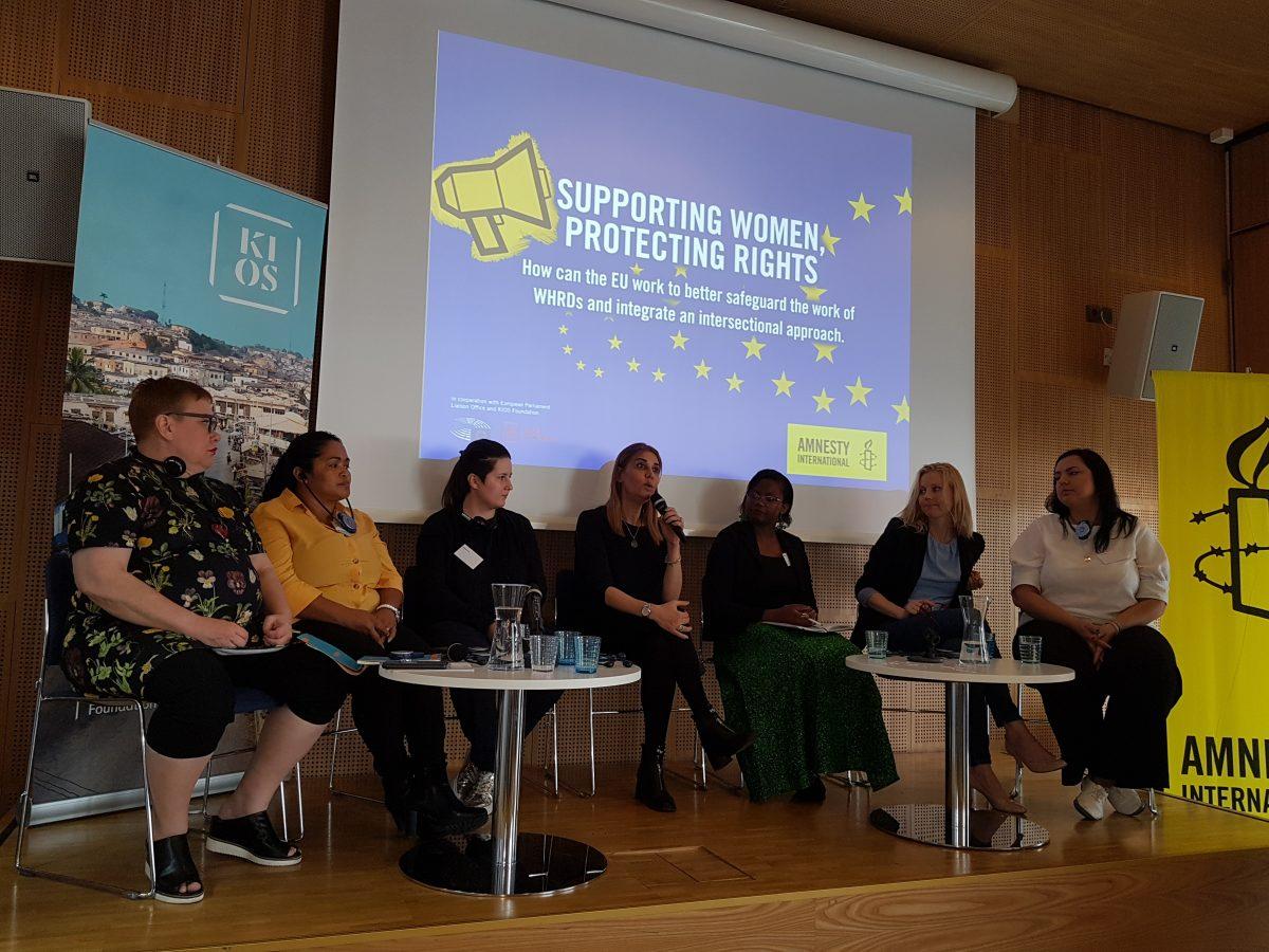 Eight women sitting side by side