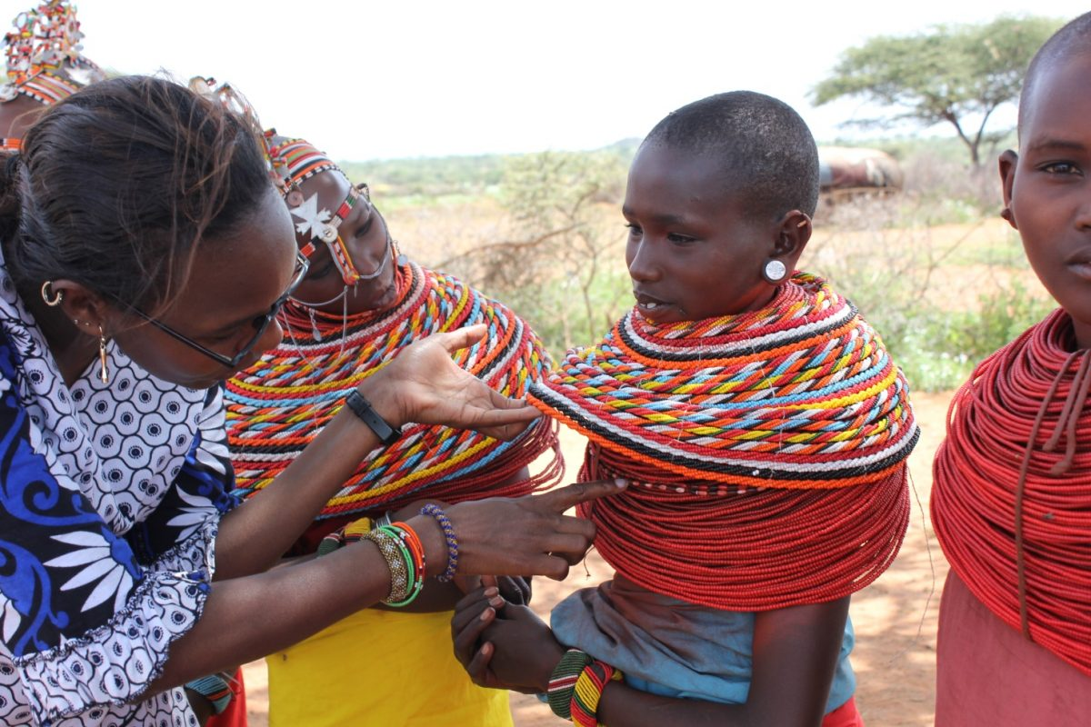 Jane Meriwas, ED of the Samburu Women Trust and a beaded girl (Photo: SWT)