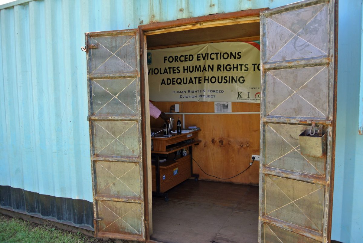 """Banner that reads """"Forced evictions violates human rights to adequate housing"""""""